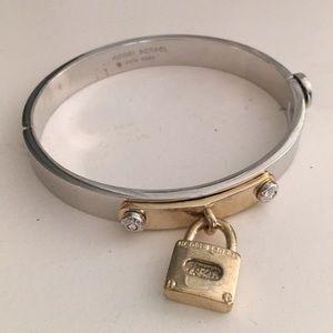 Henri Bendel bangle with lock.